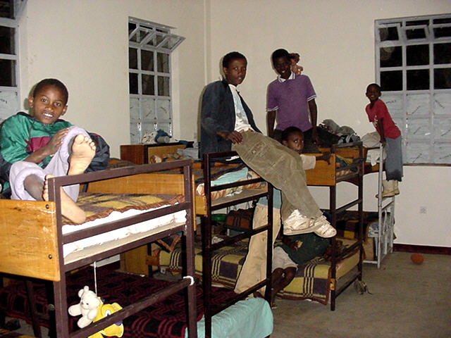 the guys are in temporary quarters and will eventually move to the lower level of the dorm their room is not quite as organized as those of the girls boys room dorm